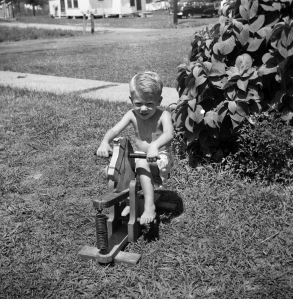 At the Green House on the rocking horse my dad built for me, summer, 1953.